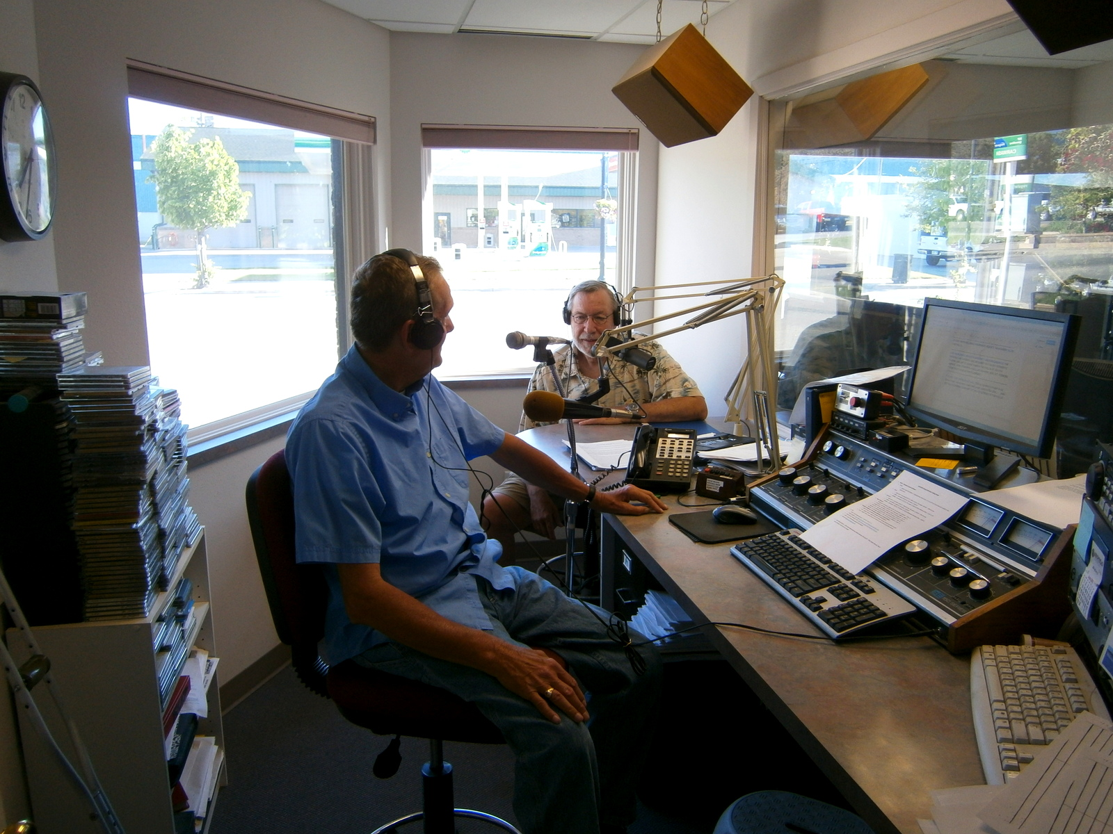 Jerry Franzen (left), KGHS Morning Host and Nolan Baratono, IRLWWB Member talk about water levels of Rainy and Namakan Lakes.  A board member participants in a 5-10 minute broadcast on water levels and flows at 7:30 a.m. on Tuesdays from April through June, and as conditions warrant.