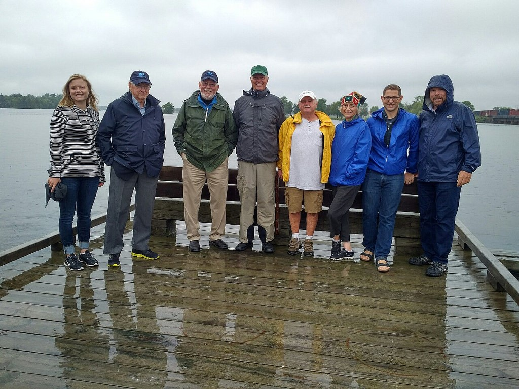 IJC Co-Chairs Gordon Walker, second from left, and Lana Pollack, third from right, pose with residents and staff on the Rainer rail bridge. Credit: IJC