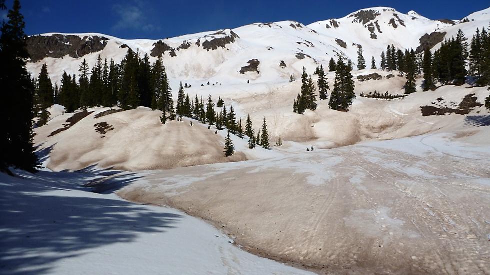 Dust particles accelerate snowmelt. Credit: Jeff Deems, NSIDC