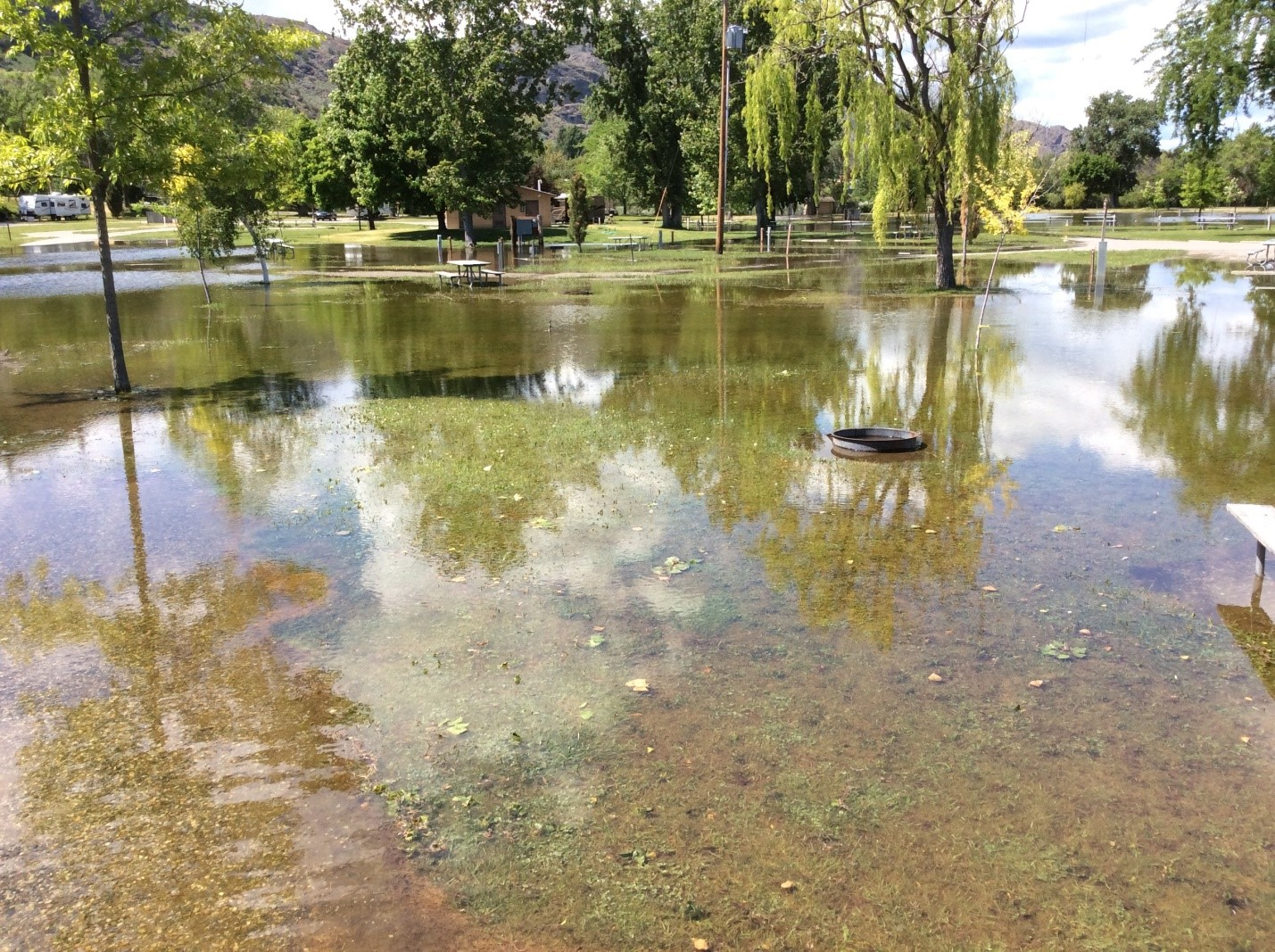 Floodwaters on Osoyoos Lake covered Veterans Memorial Park in Oroville, Washington, in early June. Waters entered communities throughout the Okanagan basin in Washington and British Columbia. Credit: Brian Symonds