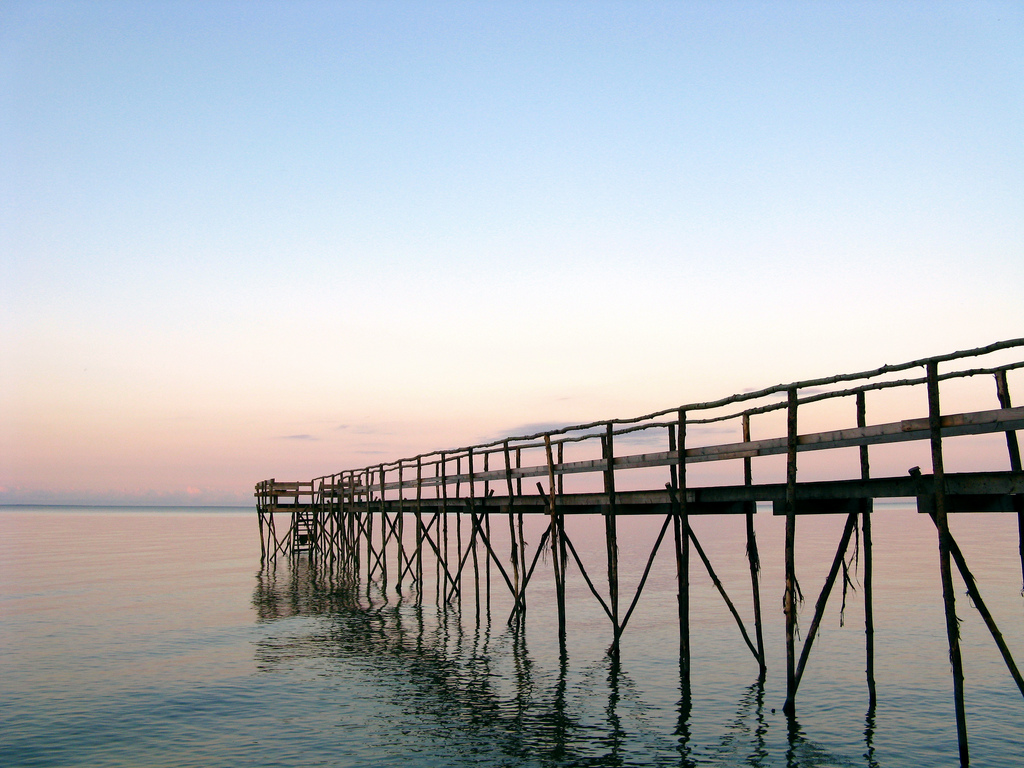 A pier at sunset on Lake Winnipeg. Credit: Steven Coutts.